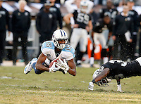 Tennessee Titans receiver Justin Hunter goes airborne to catch a pass during the game against the Oakland Raiders in Oakland, CA on November 24, 2013. Photos by Donn Jones Photography.