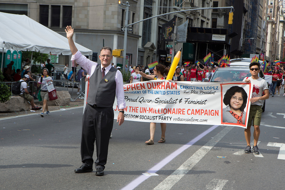 """Stephen Durham, the Freedom Socialist Party candidate for president in 2012, marches with his supporters. Durham is gay, and refers to his campaign as """"the un-millionaire campaign."""""""