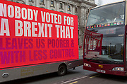 On the day that Prime Minister Theresa May's Meaningful Brexit vote is taken in the UK Parliament, a touring lorry Brexit ad drives along Whitehall to the amusement of bus tourists, on 15th January 2019, in Westminster, London, England.