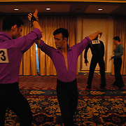 ****EMBARGO: NOT FOR PUBLICATION IN THE ADVOCATE, CURVE, GONYC OR OUT MAGAZINES..Gay ballroom dancers Andre Nadko, left, and Jorge Guzman, both of New York City, rehearse before they compete during the Dancesport competition at the Hilton Hotel and Towers in downtown Chicago during Gay Games VII on July 20, 2006. ..Over 12,000 gay and lesbian athletes from 60 countries are in Chicago competing in 30 sports during the Games from July 15 through 22, 2006. ..Over 50,000 athletes have competed in the quadrennial Games since they were founded by Dr. Tom Wadell, a 1968 Olympic decathlete, and a group of friends in San Francisco in 1982, with the goal of using athletics to promote community building and social change. ..The Gay Games resemble the Olympics in structure, but the spirit is one of inclusion, rather than exclusivity. There are no qualifying events or minimum or maximum requirements...The Games have been held in Vancouver (1990), New York (1994), Amsterdam (1998), and Sydney (2002). .