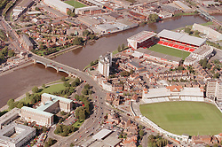 Aerial view of Trent Bridge in Nottingham with County Hall in the left foreground,  Nottinghamshire County cricket ground on the right with Nottingham Forest football ground behind river,