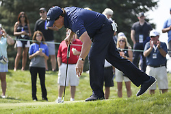September 14, 2017 - Chicago, IL, USA - Phil Mickelson finishes putting the on the 13th hole during the first round of the BMW Championship on Thursday, Sept. 14, 2017, at Conway Farms Golf Club in Lake Forest, Ill. (Credit Image: © Lou Foglia/TNS via ZUMA Wire)