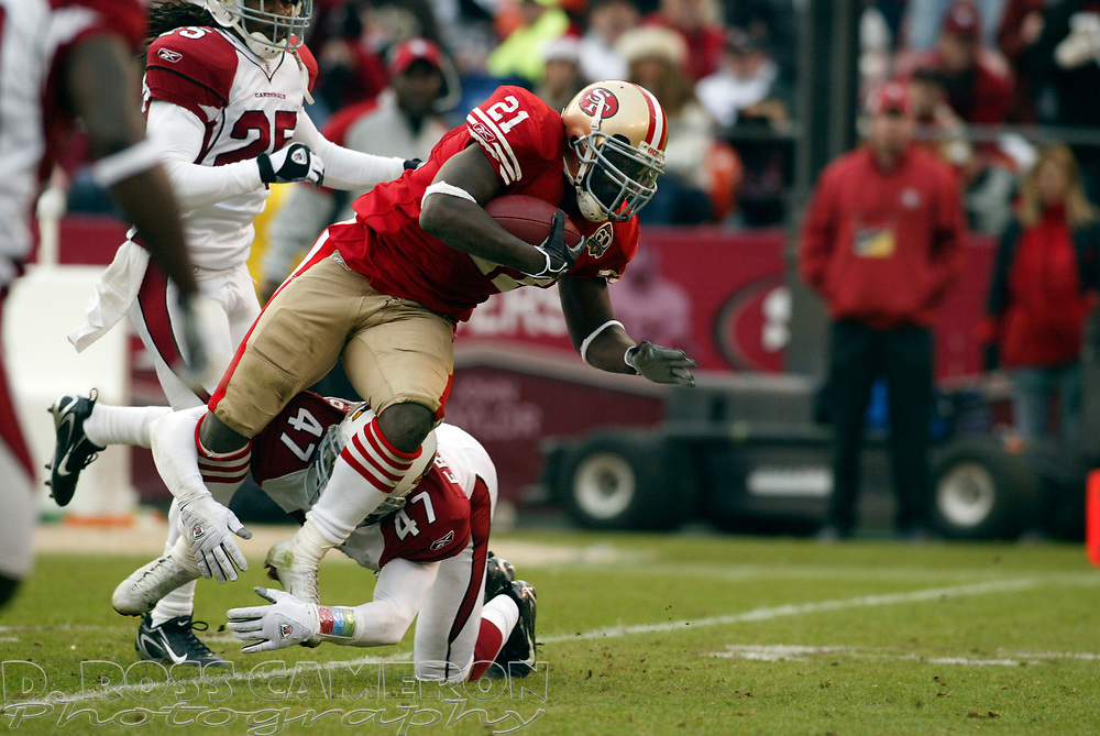 San Francisco 49ers running back Frank Gore (21) is tripped up by Arizona Cardinals defender Aaron Francisco in the third quarter of their NFL football game, Sunday, Dec. 24, 2006 at Candlestick Park in San Francisco.  The Cardinals won, 26-20. (D. Ross Cameron/The Oakland Tribune)