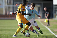 Ismail Yakubu of Newport  (l) shields the ball from Tom Nichols of Exeter. Skybet football league two match, Newport county v Exeter city at Rodney Parade in Newport, South Wales on Sunday 16th March 2014.<br /> pic by Mark Hawkins, Andrew Orchard sports photography.