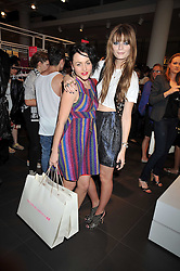 Left to right,  JAIME WINSTONE and MISCHA BARTON at a party to celebrate the launch of the Matthew Williamson collection at H&M held at the H&M store, Regent Street, London on 22nd April 2009.