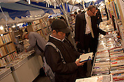 Japanese Office workers or salarymen and other shoppers enjoy a week long secondhand book market outside Shimbashi station in Tokyo. Japan The market runs from November 15th to November 21st and takes place every 5 months. Japan has a 99% literacy rate and boasts a large publishing market that has however been in steep decline since the 1990s when due to Japan`s lowering economic conditions companies like Book Off, that opened its first store in 1990 and now circulates over 200 million books a year through nearly 900 stores nationwide and internationally made the buying and selling of secondhand books popular and acceptable. Shimbashi, Tokyo, Japan November 18th 2009