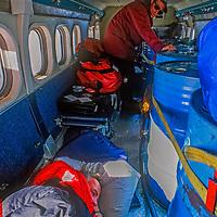 Mike Sharp sleeps in Twin Otter in Queen Maud Land, Antarctica.