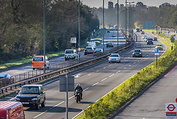 © Licensed to London News Pictures. 23/03/2020. London, UK. At 08:28 am traffic on the A3 at Kingston Vale in south west London, which is normally busy with commuters heading in to town, looked much quieter this morning as many Londoners decide to work from home or self-isolate to help in the battle against the spread of the coronavirus disease. Photo credit: Alex Lentati/LNP