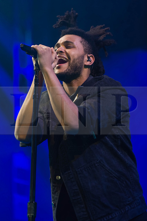 © Licensed to London News Pictures. 26/11/2013. London, UK.   The Weeknd performing live at The O2 Arena. The Weeknd (real name Abel Tesfaye) is a Canadian PBR&B recording artist and record producer. Photo credit : Richard Isaac/LNP