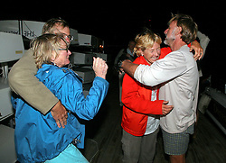 05 April 2011. St Maarten, Antilles, Caribbean.<br /> Wives of sailors see their husbands for the first time in over 9 weeks. Trisha Baily (red top) and husband David Hildred and Beryl Bainbridge (blue coat) wife of Dr Andrew Bainbridge greet their husbands as they step ashore for the first time.<br /> After more than 9 weeks at sea, having started in the Canary islands, the 'Antiki' transatlantic raft gets set to arrive in St Maarten in the Caribbean following an epic voyage. The incredible vessel is crewed by Anthony Smith (84 yrs old) British adventurer, David Hildred, sailing master and British Virgin Islands resident, Dr Andrew Bainbridge of Alberta, Canada and John Russell, solicitor and UK resident.<br /> Photo; Charlie Varley/varleypix.com