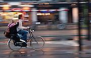 Couple riding a bike in the rain, Amsterdam.
