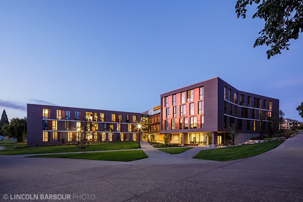 A horizontal view of Trillium Residence Hall showing the whole building from the front side at dusk.