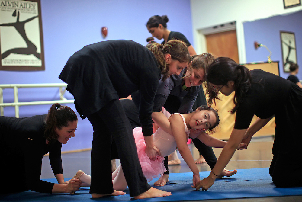 Samara Almanza is assisted with an exercise during a dance class for children with movement disabilities in Evanston, Illinois, March 25, 2012. The program is intended as physical rehabilitation to improve posture and motor control through the artistic nature of ballet in children with cerebral palsy.   REUTERS/Jim Young