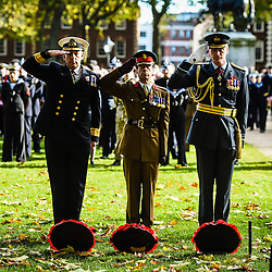 Members of the armed forces salute after laying poppy wreaths during a Remembrance Sunday service in Queen's Square, Bristol, held in tribute for members of the armed forces who have died in major conflicts.