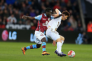 Ki Sung-Yueng ® of Swansea city holds off Idrissa Gana Gueye of Aston Villa. Barclays Premier league match, Swansea city v Aston Villa at the Liberty Stadium in Swansea, South Wales on Saturday 19th March 2016.<br /> pic by  Andrew Orchard, Andrew Orchard sports photography.