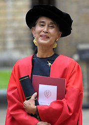 © Licensed to London News Pictures. 20/06/2012. Oxford, UK Aung San Suu Kyi leaves University today 20 June 2012 after receiving an Honary Degree at the Encaenia Ceremony.  The Burmese democracy leader is to receive an honorary doctorate in civil law at annual ceremony honouring the brightest and best. Other honorees include: former MI5 Director General Baroness Manningham-Buller; author David John Moore Cornwell (aka John le Carre); Harvard University president Professor Drew Gilpin Faust; and Sony chief executive Sir Howard Stringer. Photo credit : Stephen Simpson/LNP