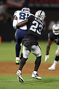 Seattle Seahawks rookie wide receiver Amara Darboh (84) leaps and catches a pass good for a first down as he gets hit by Oakland Raiders cornerback Dexter McDonald (23) in the fourth quarter during the 2017 NFL week 4 preseason football game against the Oakland Raiders, Thursday, Aug. 31, 2017 in Oakland, Calif. The Seahawks won the game 17-13. (©Paul Anthony Spinelli)