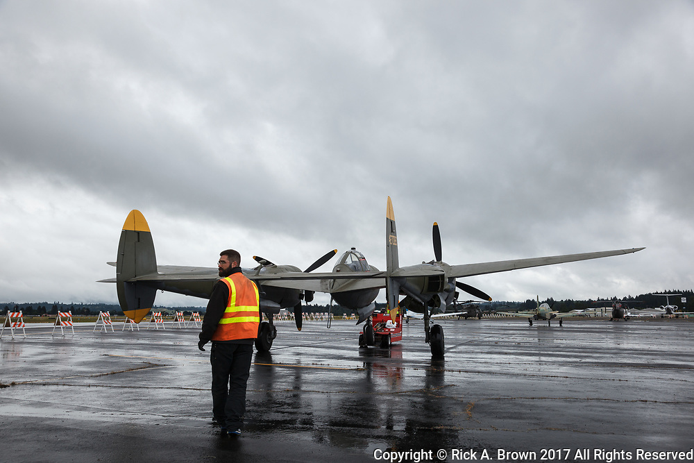 Erickson Aircraft Collection's P-38 Lightning being moved at Warbirds Over the West.