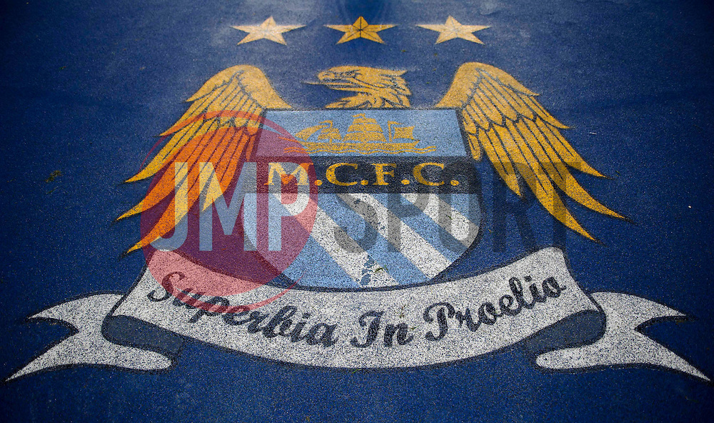 A general view of the Man City crest on the tunnel floor - Photo mandatory by-line: Rogan Thomson/JMP - Tel: 07966 386802 - 18/02/2014 - SPORT - FOOTBALL - Etihad Stadium, Manchester - Manchester City v Barcelona - UEFA Champions League, Round of 16, First leg.