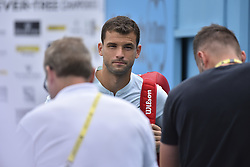 June 19, 2018 - London, England, United Kingdom - Bulgaria's Grigor Dimitrov attends match against Bosnia and Herzegovina's Damir Dzumhur during their first round men's singles match at the ATP Queen's Club Championships tennis tournament in west London on June 19, 2018. Dimitrov won the match 6-3, 7-6, 6-3. (Credit Image: © Alberto Pezzali/NurPhoto via ZUMA Press)