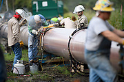 Workers welding a section of a gas pipeline in Florida