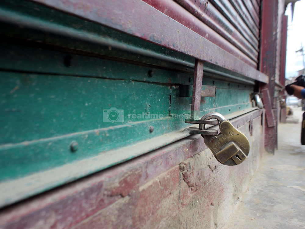 July 19, 2017 - Anantnag, Jammu and Kashmir, India - Bijbehara Town observed Shutdown against the killing of a civilian, Mohammad Abdullah Ganie on Wenesday, 19 july.  Ganai, succumbed to his injuries at SKIMS Soura Tuesday afternoon. Ganaie was injured after Army men allegedly opened fire in Bijbehara town on Monday afternoon during an altercation between the locals and army men. (Credit Image: © Muneeb Ul Islam/Pacific Press via ZUMA Wire)