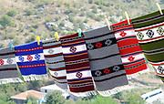 Bright woven rugs  for sale to tourists on the road to Rozafa castle, Kalaja e Rozafës. Shkodër, Albania. 02Sep15.