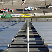 Cars go by an empty grandstand during the Herr's Potato Chips 200 ARCA race at the Toledo Speedway in Toledo on Saturday, June 13, 2020. Spectators were not allowed at this race due to coronavirus concerns. THE BLADE/KURT STEISS
