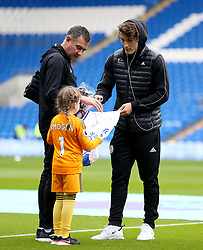 Leicester City's Caglar Soyuncu signs a shirt for the match day mascot before the match