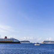 North America, Caribbean, Cayman Islands, Cayman, Grand Cayman, Georgetown, <br /> Massive cruise ships lining up in the harbor, Georgetown, Grand Cayman.