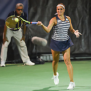 MONICA PUIG hits a forehand during her second round match at the Citi Open at the Rock Creek Park Tennis Center in Washington, D.C.