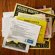RALEIGH, NC - FEBRUARY 23:  Many residents living in the South Park section of Raleigh experience a high number of solicitation from developers to purchase their homes. This stack was seen at a home off Lee Street on February 24, 2019 in Raleigh, NC. (Logan Cyrus for The New York Times)