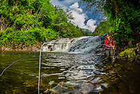 Flyfishing guide from Sitka Alaska Outfitters fishing the Lower Falls of Sawmill Creek, near Sitka, Alaska USA.
