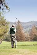 Male Golfer Taking a Swing at Marshall Canyon Golf Course