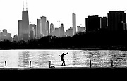 Alex Resurreccion of Chicago, enjoys the warming temperatures in Montrose Harbor as he works on his balance Monday March 16, 2009, in Chicago.  (Charles Cherney/Chicago Tribune) ..OUTSIDE TRIBUNE CO.- NO MAGS,  NO SALES, NO INTERNET, NO TV, CHICAGO OUT.. 00304771C Weather c