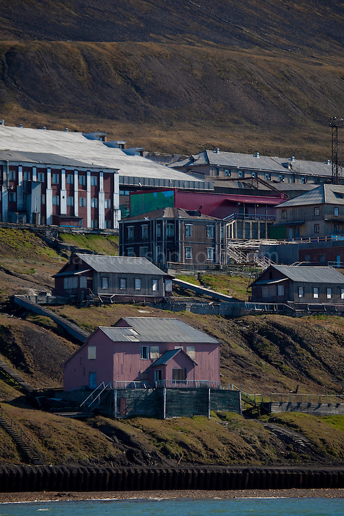 A view of Barentsburg from an approaching ship. Barentsburg is a Russian coal mining town in the Norwegian Archipelego of Svalbard. Once home to about 2000 miners and their families, less than 500 people now live here.