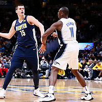 11 November 2017: Denver Nuggets center Nikola Jokic (15) passes the ball over Orlando Magic center Bismack Biyombo (11) during the Denver Nuggets 125-107 victory over the Orlando Magic, at the Pepsi Center, Denver, Colorado, USA.