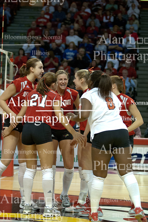 20 November 2004....Kelly Rikli (center) grimaces with joy after getting a kill.....Illinois State University Redbirds V Drake Bulldogs Women's Volleyball.  Redbird Arena, Illinois State University, Normal IL