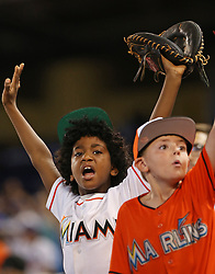 July 16, 2017 - Miami, FL, USA - A couple of young fans try to get the players attention as the Miami Marlins host the Los Angeles Dodgers on Sunday, July 16, 2017. (Credit Image: © Patrick Farrell/TNS via ZUMA Wire)