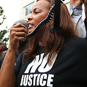 """Natalie Jackson speaks to the crowd on the steps of the Orange County Courthouse during the No Justice No Peace- """"March Against Gun Violence""""  walk from Lake Eola in downtown Orlando, to the Orange County Courthouse on Wednesday, July 17, 2013. The march was organized by the Modarres Law Firm and Orlando attorney Natalie Jackson, one of the attorneys for Trayvon Martins parents. (AP Photo/Alex Menendez)"""