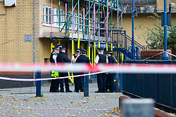 A large police cordon remains in place following the murder on October 17th of Ian Tomlin, 46, at the high-rise Doddington Estate in Battersea, South London . Battersea, London, October 18 2018.