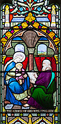 Stained glass window East Bergholt church, Suffolk, England, UK c 1837 by W H Constable of Cambridge, detail of baby Jesus sitting with Blessed Virgin Mary artist painting a picture of them, The Grace of God was Upon Him