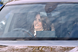 The Duchess of Cambridge and Prince Louis arriving for the Queen's Christmas lunch at Buckingham Palace, London.