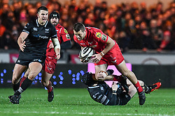 Scarlets' Paul Asquith is tackled by Ospreys' Sam Davies - Mandatory by-line: Craig Thomas/Replay images - 26/12/2017 - RUGBY - Parc y Scarlets - Llanelli, Wales - Scarlets v Ospreys - Guinness Pro 14