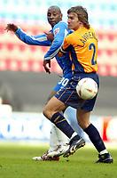Photo: Chris Brunskill. Wigan Athletic v Millwall. Coca-Cola Championship. 12/03/2005. Matt Lawrence of Millwall blocks Jason Roberts of Wigan.