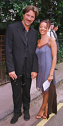 MR & MRS DAVID SEAMAN he is the English football goal keeper, at a party in London on 30th June 1999.MTY 49
