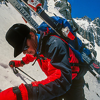 Ski Mountaineer Mike Rufer Clinmbs the V-Notch Couloir above the Palisade Glacier in California's Sierra Nevada