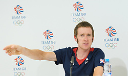 Bradley Wiggins<br /> Gold medlaist <br /> in Olympic Time trials at Hampton Court <br /> 1st August 2012<br /> Press Conference <br /> <br /> <br /> Olympics London 2012 <br /> <br /> Bradley Wiggins<br /> <br /> <br /> Photograph by Elliott Franks<br /> <br /> Bradley Marc Wiggins, CBE (born 28 April 1980) is a British professional track and road cyclist, riding for the UCI ProTeam Team Sky. Wiggins began his career on the track, but has made the transition to road cycling, becoming one of the few cyclists to gain success in both disciplines. He won the 2012 Tour de France, becoming the first British winner in its 99-year history.