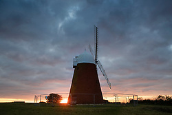 © Licensed to London News Pictures. 19/11/2019. Chichester, UK. The morning sun rises behind the Halnaker Windmill near Chichester. Freezing temperatures and fog are hitting parts of the south. Photo credit: Peter Macdiarmid/LNP