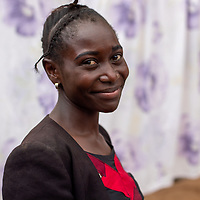 A young woman who is part of a community group to help build a well with support from IMA and Tearfund in Butembo, Congo. Clean drinking water underpins many initiatives for healthcare in  the region.